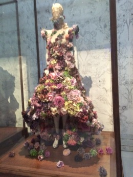 Originally made from real flowers, the dress fell apart on the runway, symbolising life and its destruction.